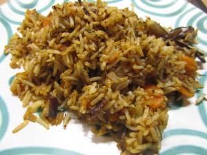 Reis mit Aubergine und Möhrchen